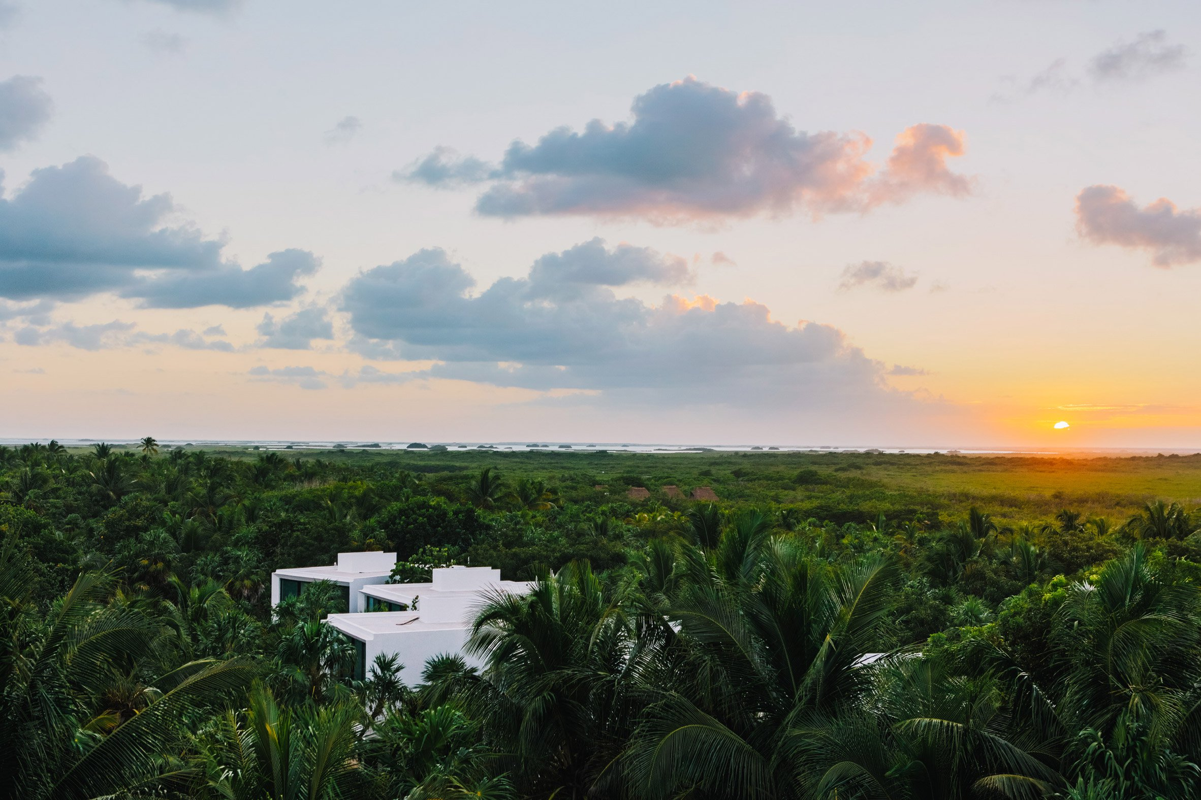 A notorious art dealer from New York Lio Malca decided to make a luxurious boutique hotel of this beautiful seaside house, owned earlier by Pablo Escobar. This Tulum boutique hotel is filled with a huge art collection.  | www.AuthenticInterior.com