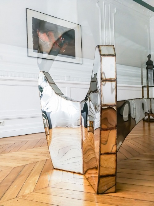 Exceptional, collectible dining table by an artist, made of a Welded mirror finish stainless steel and glass. Interior design in Paris, by Authentic Interior design studio, Aida Sniraite