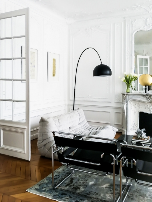 Modern luxury living room. Wassily chairs, vintage kilim, marble coffee table in a Haussman building. Living room detail - collectible artwork. Interior design in Paris, by Authentic Interior design studio, Aida Sniraite